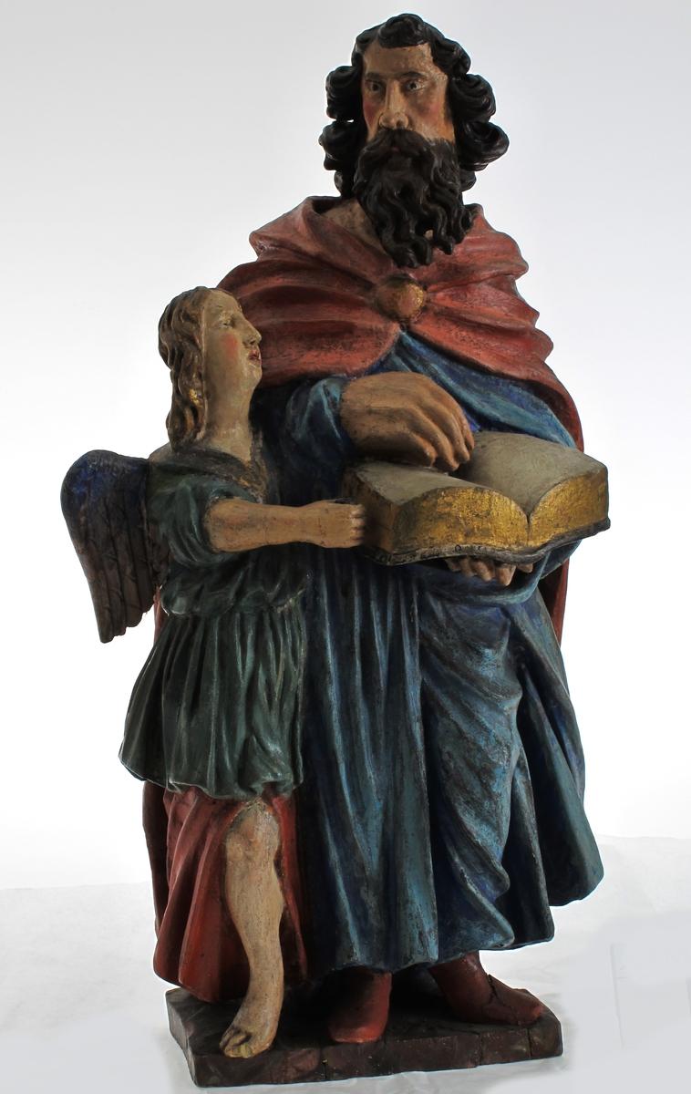 Stående mannsfigur, m. oppslått bok. Evangelisten Mattheus med engelen,