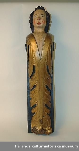 Karyatid av trä. Guldfärgat akantushölster, gråblå bottenplatta.