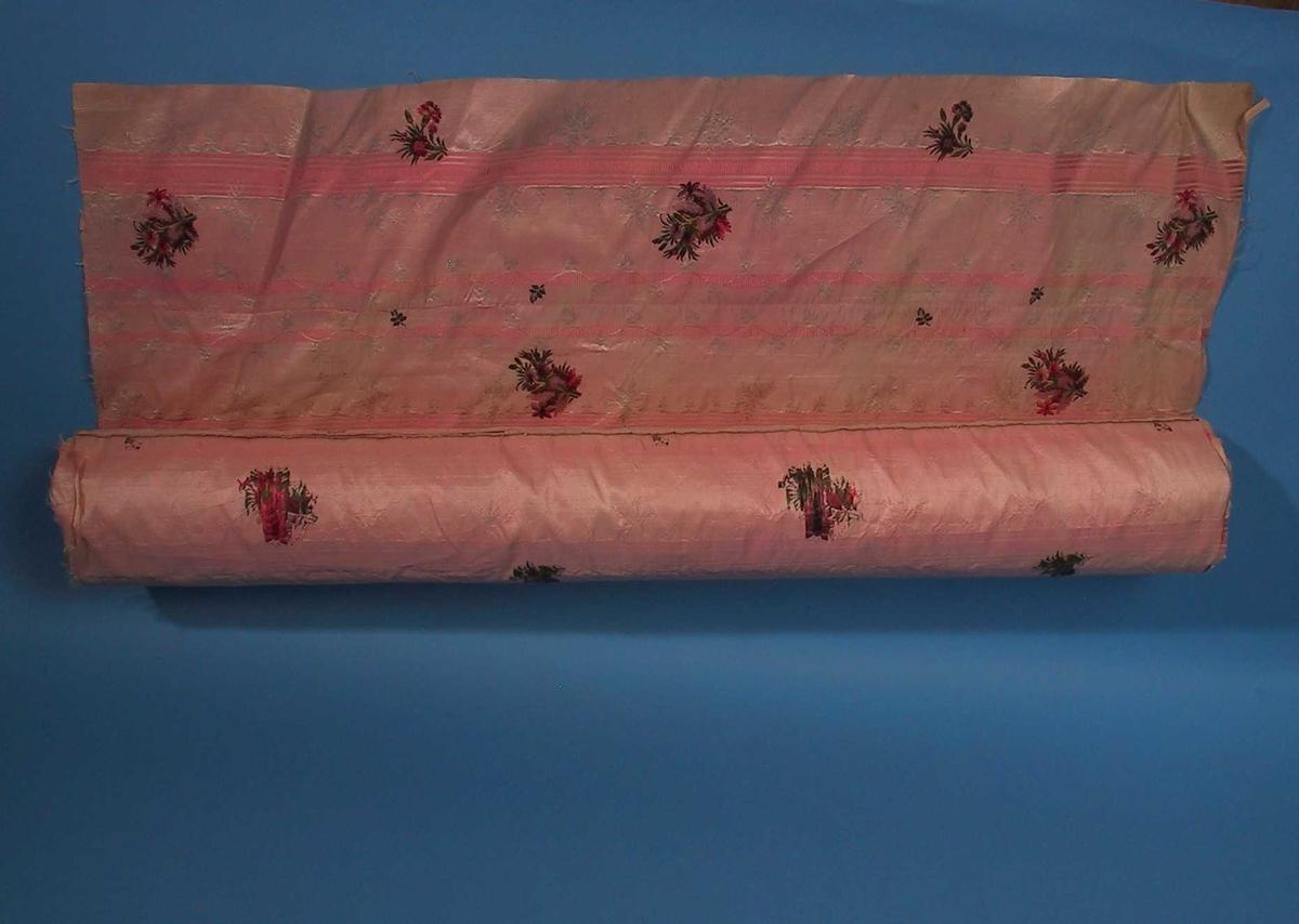 Stripet rosa, brosjerte blomster/ Strøblomster med små grønne blad,