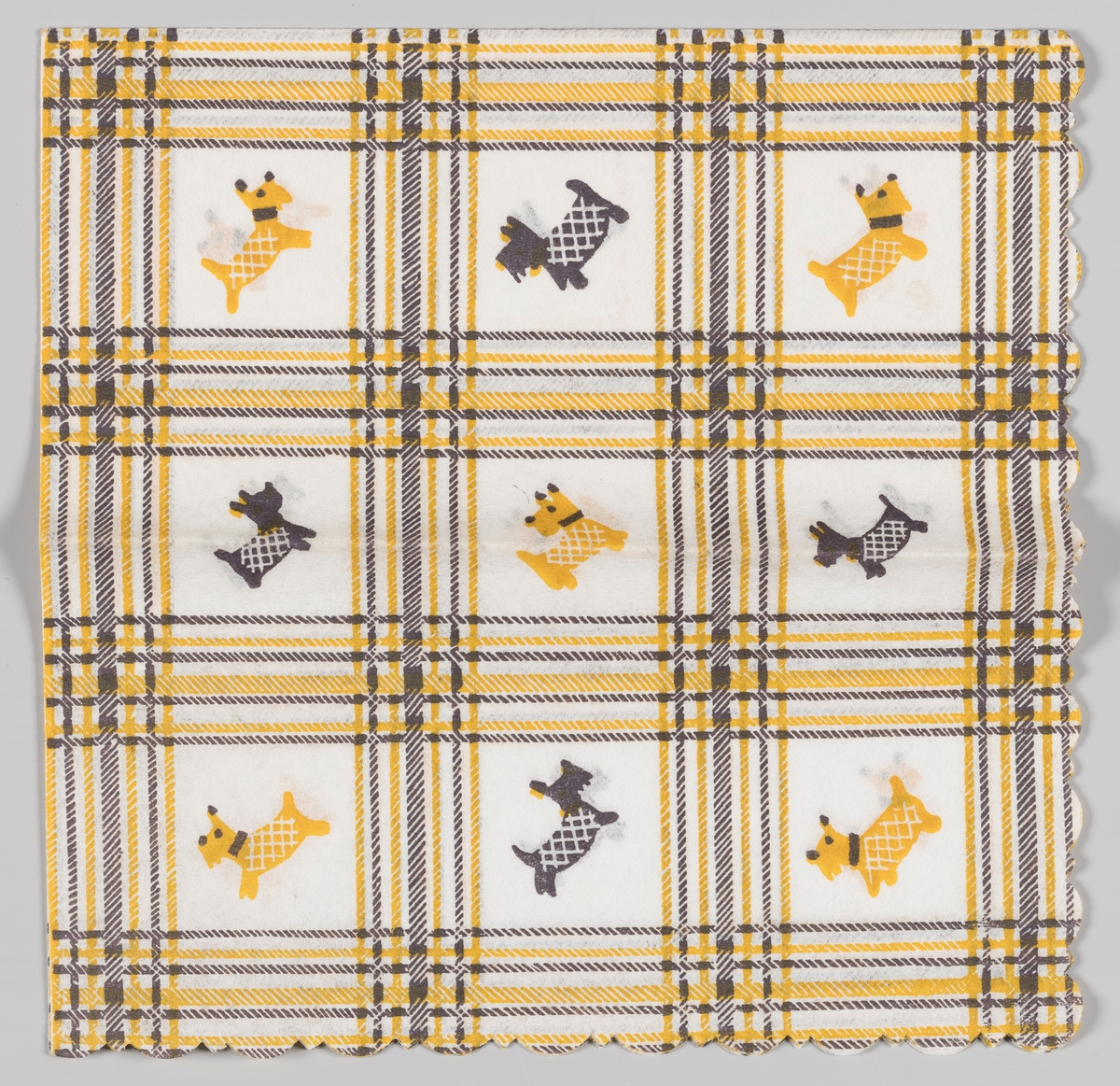 Et rutemønster med 9 felter. I hvert felt er plassert en hund som enten er sort eller gul. Hundene har på rutete hundedekken.