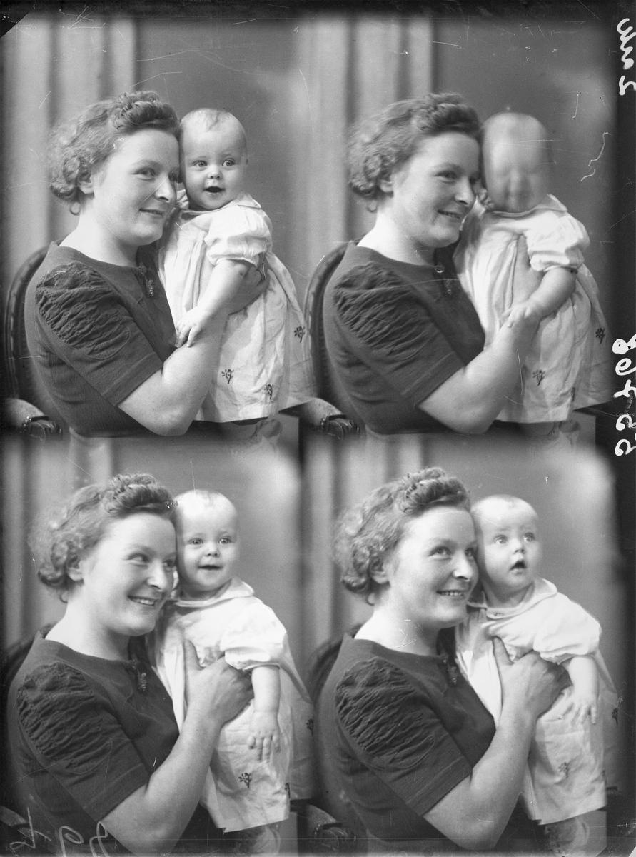 Portrett. Ung mørkhåret kvinne i mørk kortermet kjole med et lite barn på fanget ikledd kort lys kjole med blomsterpynt. Bestillt av Agnes Olsen. Rådhusgt. 63