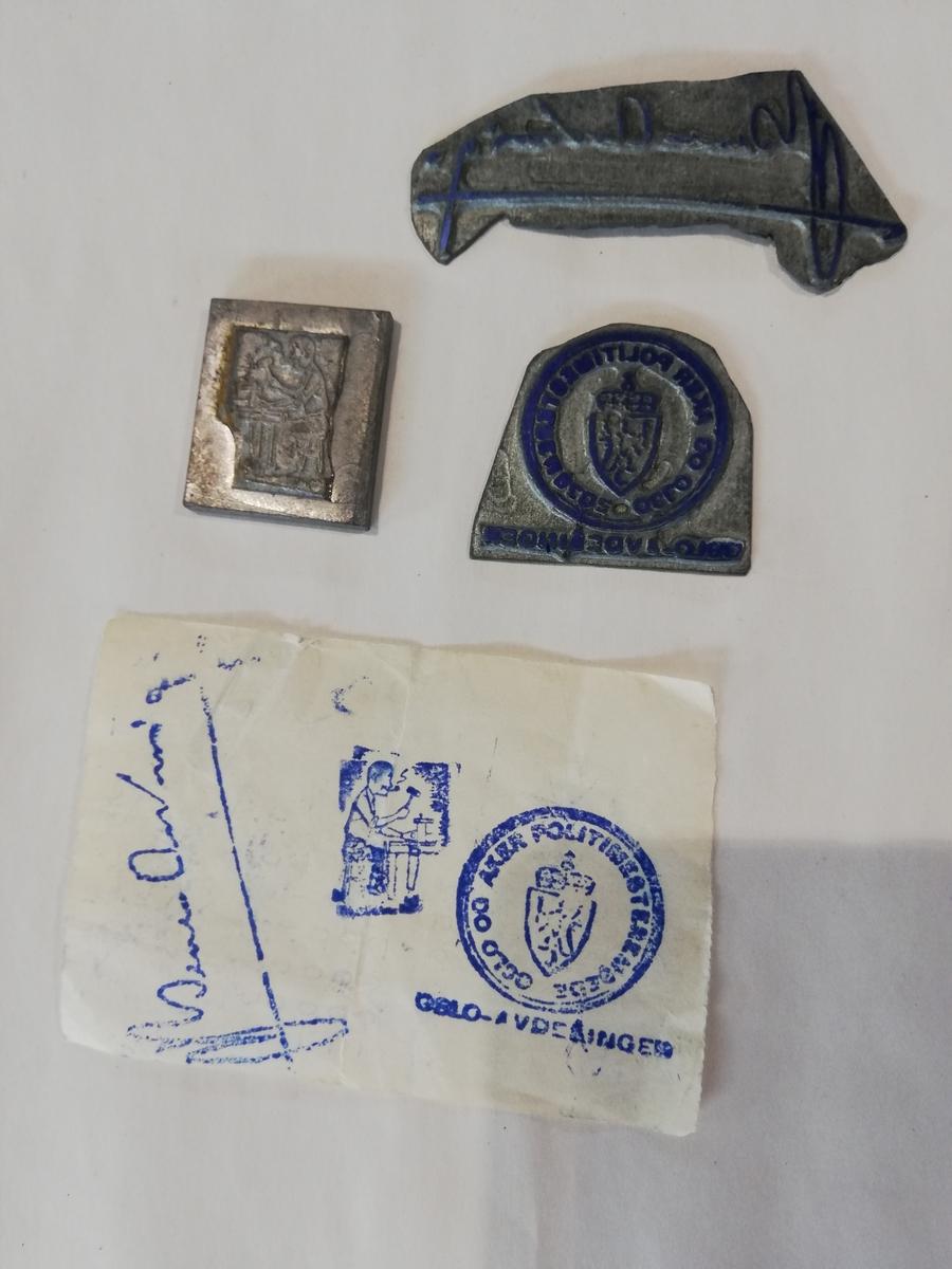 3 stk stempelplater. En med en signatur, en med tegning av en handverker og en med Oslo og Aker Politimesterembede Oslo Avdelingen.
