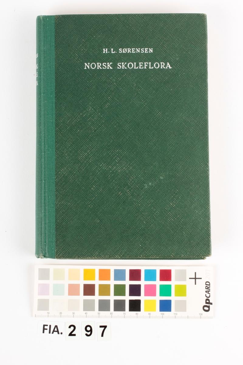 Skoleflora i grønt bind.