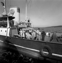 Reportagebilder från hamnen med bland annat SCA:s bogserbåt