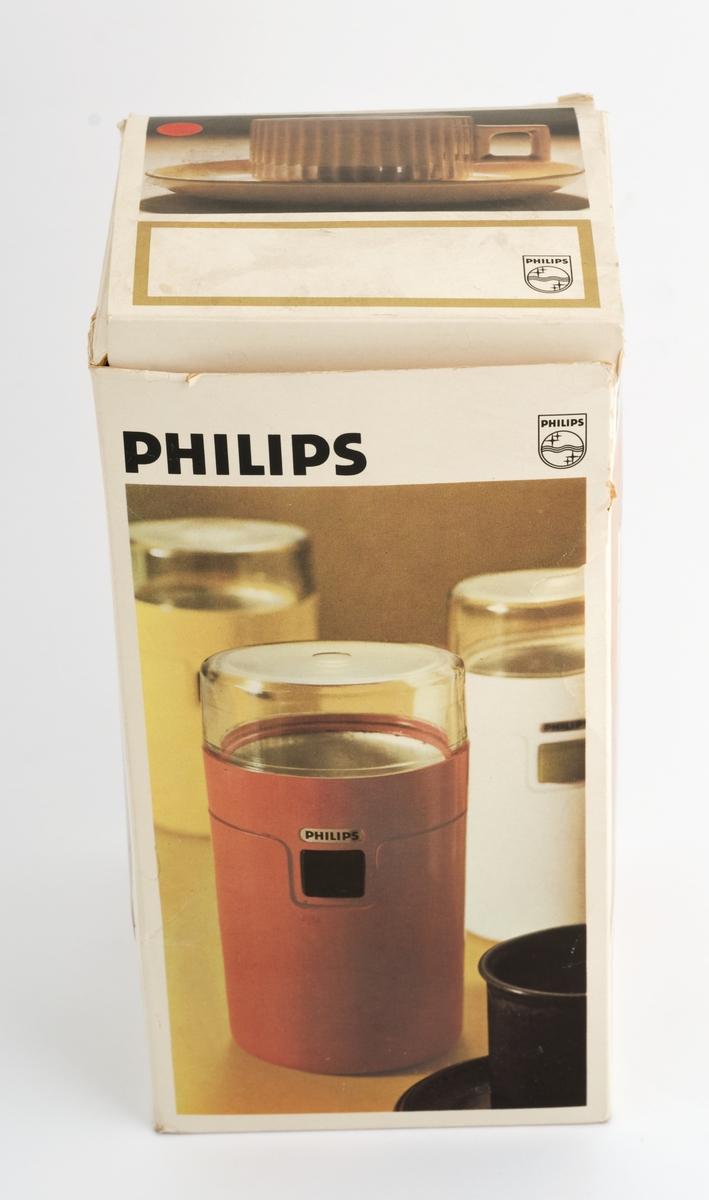 Kaffekvern i originaleske. A: eske B: kvern C: lokk D: bruksanvisniong E: garantibevis FG: isoporstøtter.