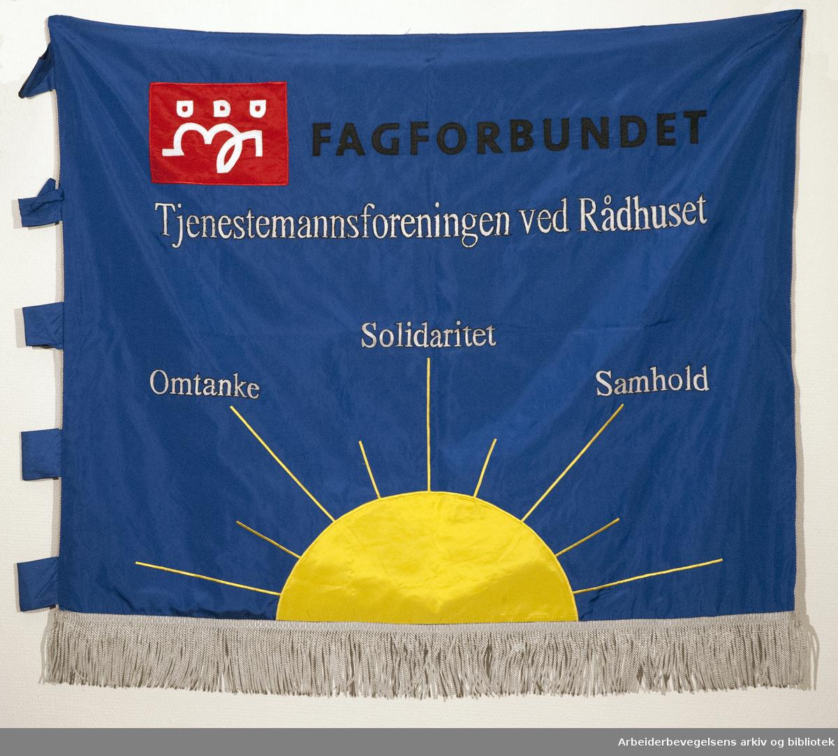 Tjenestemannsforeningen ved Rådhuset.stiftet 2. oktober 1934..Forside..Fanetekst: Fagforbundet.Tjenestemannsforeningen ved Rådhuset.Omtanke Solidaritet Samhold