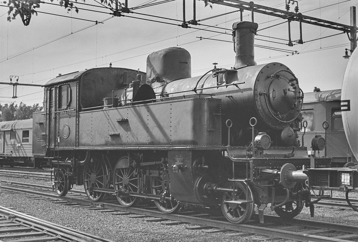 Svensk damplok med akselrekkefølge 1'C'1 på Ed stasjon i Sverige.