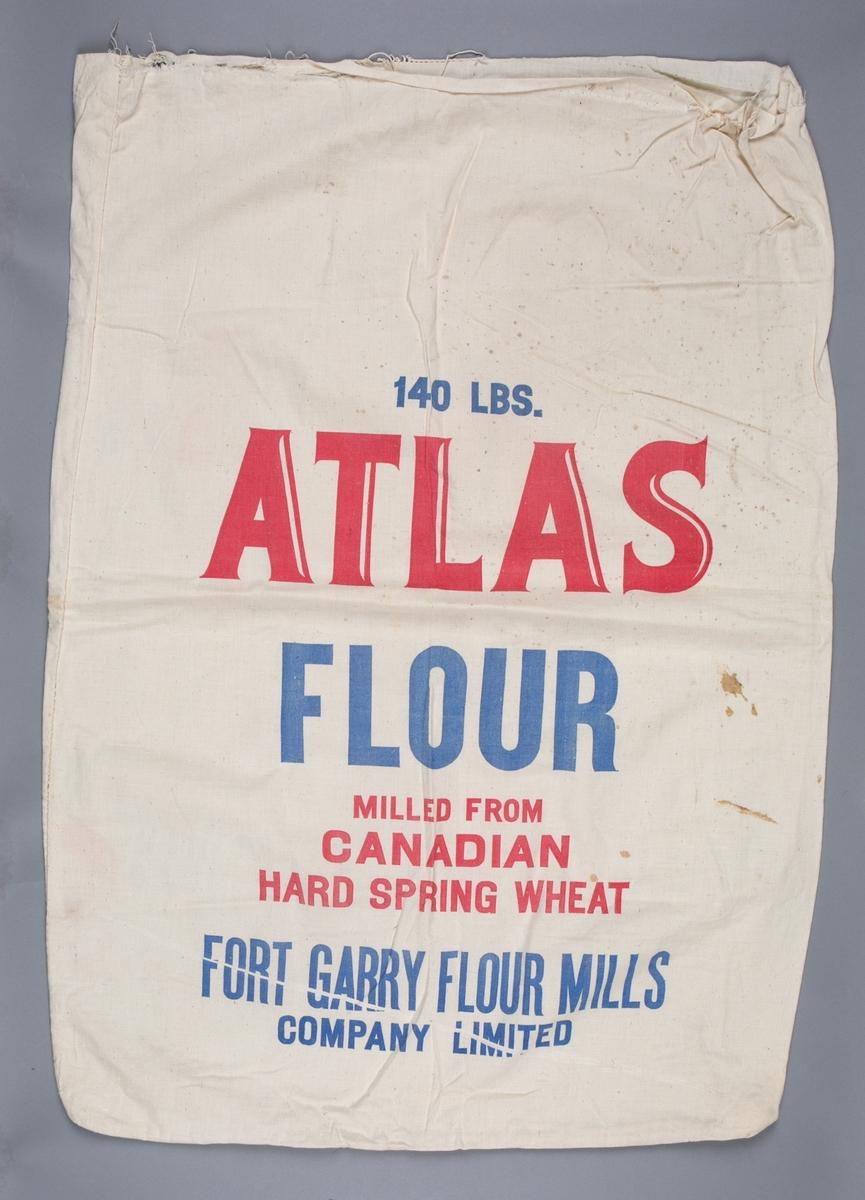 Melsekk  i hvit lin med tekst. Benyttet for transport av hvetemel.