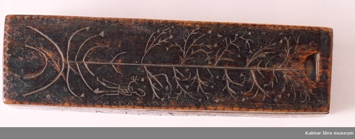 Motiv med träd och människa.